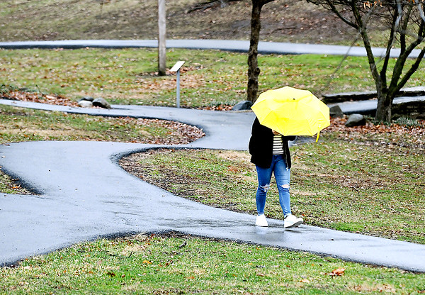 A rainy day walk through the valley of Anderson University Tuesday afternoon required  a good umbrella and heaver jacket as the temperatures dropped throughout the day with a steady rain falling on northwest winds.
