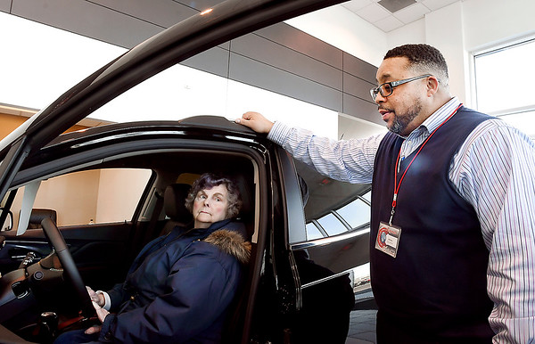 Autoworld of Anderson was voted Best Of sales staff in THB's Best Of voting. Here sales associate William Bruner shows Loretta Watson the interior features of this Buick SUV.