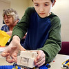 Corbin Estep, 9, adds another Lego piece as he creates a mini-figure adventure during the Lego Club event at the Lapel Branch Library Monday afternoon. Estep, a 3rd grader at Lapel Elementary School, enjoys taking part in the Lego Club activities at the library.