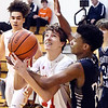 Liberty Christian's Landan McCord eyes the basket as he goes up for a shot as Smith Academy's Adrian Thomas is all over him and was called for a foul on the play.