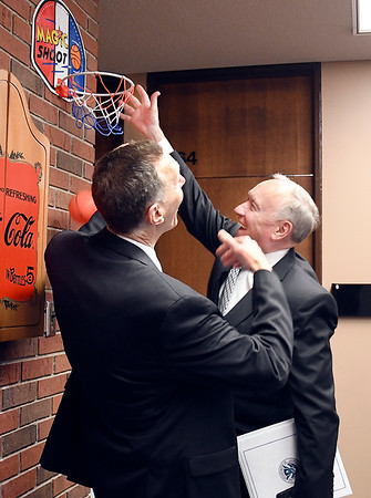 Assistant Security of Homeland Secretary John Hill gets a dunk over Anderson University President John Pistole in the History/Political Science Department before Hill met with a gathering of students in the Situation Room Thursday.