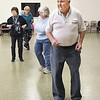 George Leisure gets his exercise as he moves with the music during line dance classes at the Rangleline Community Center.