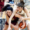 Alexandria's Reiley Hiser and Catherine Duncan of Monroe Central fight over a loose ball.