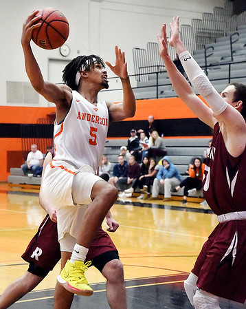 AU's Michael Rogers goes up strong to the basket.