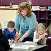 Frankton Elementary School 2nd grade teacher Gail Small helps one of her students.