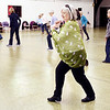 Julia Dotson turns and steps with the music, along with her fellow line dancers, Wednesday afternoon at the Rangeline Community Center during dance class. Stacia Williams, of Generations of Steppers, conducts line dance classes every Wednesday afternoon from 3-4 p.m. at the center.