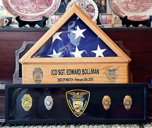 These are some of the items of remembrance for Indiana Conservation Officer Sgt. Ed Bollman who died two years ago while attempting to save his friend Roger Chezem while ice fishing.