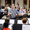 Liberty Christian School band director Mike Synder conducts the school band at the department's second annual Dinner Theater Concert held at Park Place Church of God fellowship hall Monday evening. The event is a major fund raiser for the school band program and with the large turnout from last year's event they are holding a second dinner concert this evening at the church from 6-8 p.m.