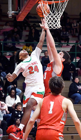 Anderson's Dayveon Turner goes strong to the basket as Fishers Jeffrey Simmons tries to block his shot.
