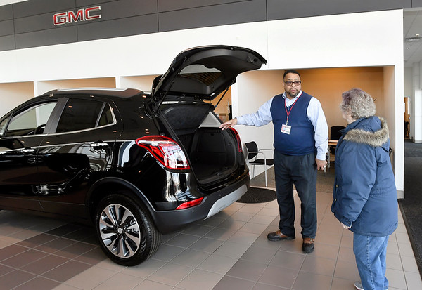 Autoworld of Anderson was voted Best Of sales staff in THB's Best Of voting. Here sales associate William Bruner shows Loretta Watson the  features of this Buick SUV in their showroom recently.