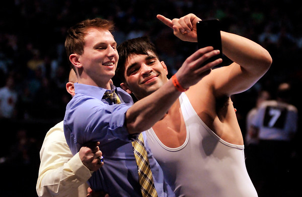 Shenandoah's Silas Allred poses for a celebratory selfie with his coaches after winning the state championship at 195 pounds during the state finals at Bankers Life Fieldhouse on Saturday.