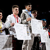 Shenandoah's Silas Allred stands atop the awards podium after winning the 195 pound title during the state finals at Bankers Life Fieldhouse on Saturday.