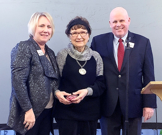 From left, Marcy Fry, executive director of the Elwood Chamber of Commerce, Theresa Mangas and board member Tom Austin pose after Mangas was honored with the Raeburn O'Malley Cannon Citizen of the Year Award at the Chamber's annual Celebration and Awards Dinner Thursday night at the Elwood Opera House.