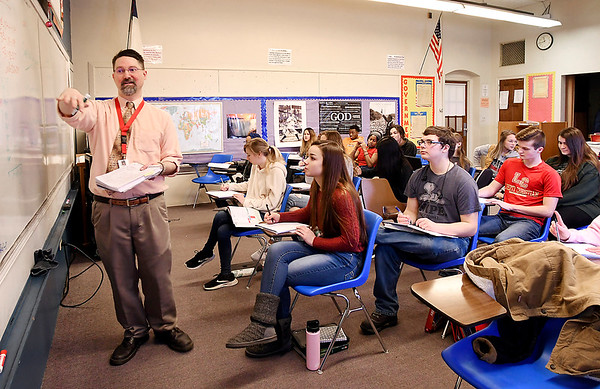 Liberty Christian High School teacher Jeff Stickler conducts his senior economics class this past week. Liberty Christian was the only school in the area that had a 100 percent graduation rate.