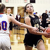 Lapel's Delany Peoples drives by Elwood's Claudia Leavell to the basket for a layup.