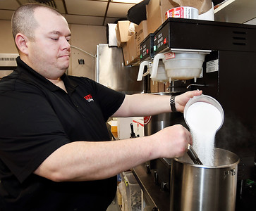 Lee's Famous Recipe Chicken won Best Iced Tea in THB's Best Of voting. Here Keith Moody, owner of the local franchise, adds sweetener to this freshly brewed batch of tea to make their sweet tea.