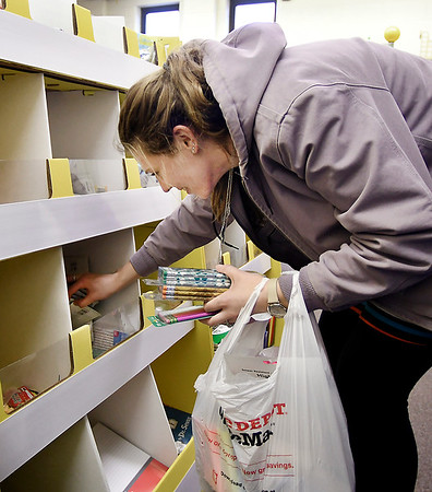 Rachel Gerstbaur, a student teacher at Anderson High School, looks for other items she might need in her classroom at the new Classroom Closet for ACS teachers this past week.