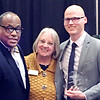 Jonathan Cook, right, is joined by Obadiah Smith and Nancy Vaughan after being named 2020 volunteer of the year.