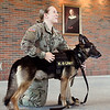 U.S. Army Specialist Amy Maulo and her K-9 partner, Sgt. Batman, give a presentation on military working dogs to Anderson University's Criminal Justice students Wednesday at Reardon Auditorium. Maulo and Batman are stationed at Fort Lee, Virginia.