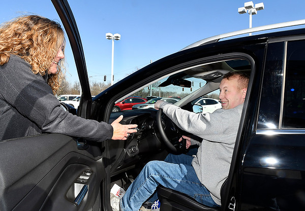 Autoworld sales associate Kim Summers goes over some of the features on this Ford as Eric Schronce, and his wife Kathi, take delivery of their new vehicle Saturday from Myers Autoworld.