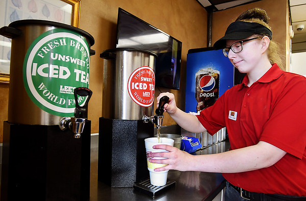 Lee's Famous Recipe Chicken won Best Iced Tea in THB's Best Of voting.<br /> Employee Morgan Jones fills a cup of sweet iced tea for a customer.