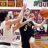 Daleville's Camden Leisure eyes the basket as he drives the lane against Alexandria defenders Rylan Metz and Jagger Orick.