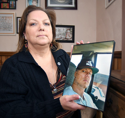 Sandy Stapleton, whose son Tommy was killed last year, has started a grief support group for friends and relatives of victims of gun violence.<br /> Here Sandy holds her favorite photo of her son.