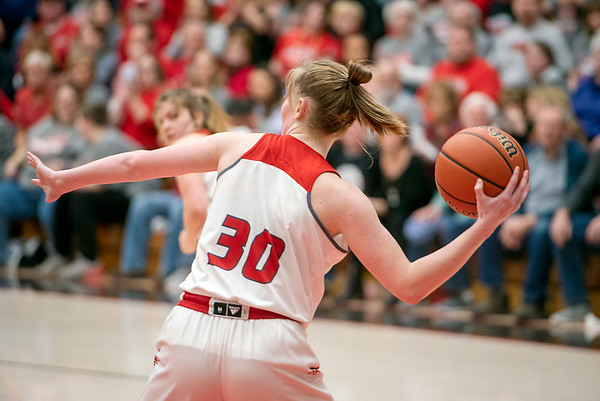 Sophmore Lauryn Bates passes the ball across the court.