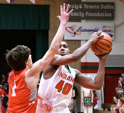 Anderson's Tyrelle Wills looks for a shot as Fishers Dominic Castellani defends.