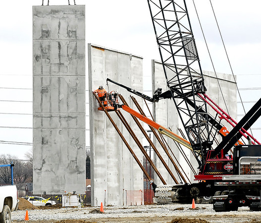 Workers starting erecting the pre-formed wall sections Thursday for the new SER North America plastics recycling facility being build on the former Guide Lamp property west of Sirmax. SER North America is investing $17.6 million in the 130,000-square-foot facility.