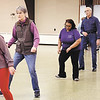 Stacia Williams, center, of Generations of Steppers, leads the dance from the middle of the pack as she conducts her line dance classes at the Rangeline Community Center recently.