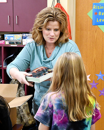 Frankton Elementary School 2nd grade teacher Gail Small passes out new math textbooks to her students Friday.