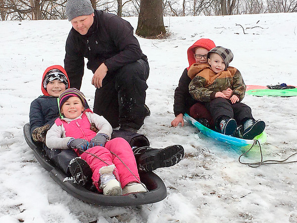 "Adam Peercy was at Shadyside Park in Anderson with his children, Dianna, 7, and Luke, 11, on Sunday. They were joined by Braxton, 8, and Brayden, 4, Watson. ""It's more slush than snow,"" Peercy said after launching his children down the slope in their sleds."