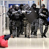 APD's SWAT team moves toward a simulated shooting victim as they run through three shooting scenarios as part of their training at Anderson Preparatory Academy on Wednesday.