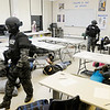 APD's SWAT team clears a classroom checking all the students for weapons and taking a head count  as they run through three shooting scenarios as part of their training at Anderson Preparatory Academy on Wednesday.