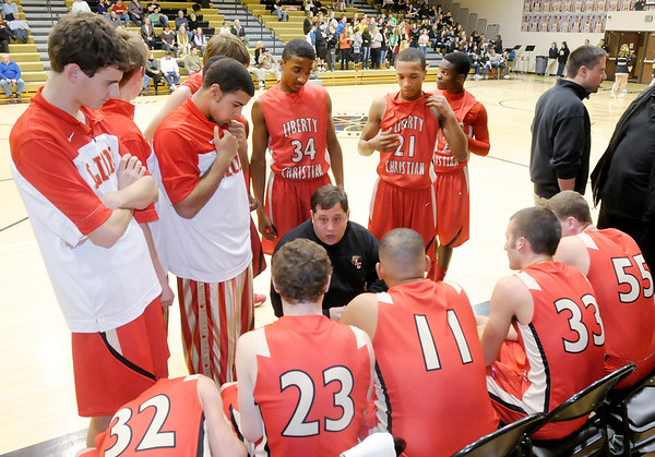 Liberty Christian coach Jason Chappell talks to his team during a time out as the Lions faced the Madison-Grant Argylls on Tuesday.