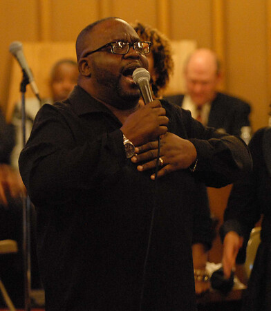 John Jackson sings with the Anderson Community Choir at the 34th Annual Dr. Martin Luther King Jr. Service held sunday at the Sherman Street Church of God in Anderson.