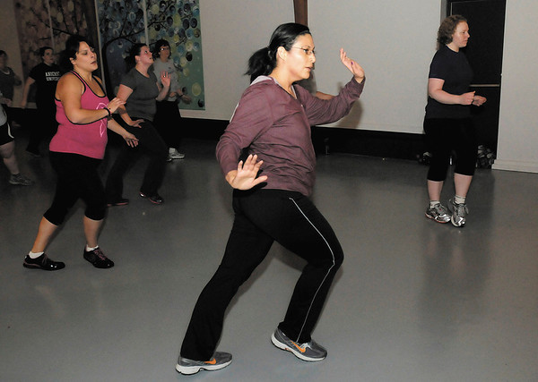 Suahil Housholder takes part in the Eastside Church of God Zumba class on Thursday. Housholder's son Benjie died unexpectedly during childbirth. The Benjie Fund is named in his memory and helps offset funeral costs for those like Suahil who lose a child during childbirth. A Zumbathon at the Mounds Mall on January 20th will raise money for the fund.