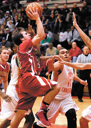 AHS's Tyler Jackson drives through the lane to the basket for a layup.
