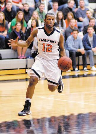Anderson University sophomore Jamares McCloud drives toward the basket for the Ravens.