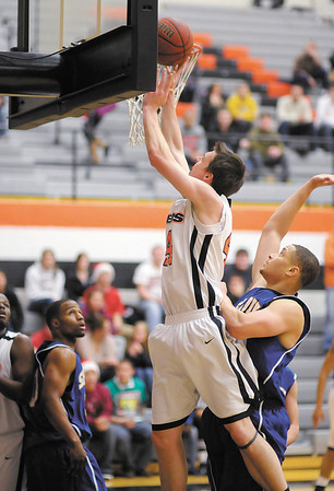 Anderson University's Nate Gross scores from the low post as the Ravens hosted Spalding University on Wednesday December 12, 2012.