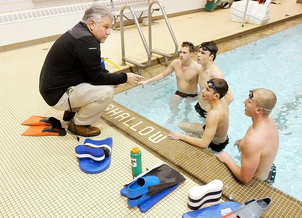 Anderson Boy's swim coach Jeff Eddy talks with Tyler Davidson, Adam Scott, Hamilton Smith and Jason Cramer during practice on Thursday.