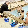 Anderson Boy's swim coach Jeff Eddy talks with Tyler Davidson, Adam Scott, Hamilton Smith and Jason Cramer during practice on Thursday.