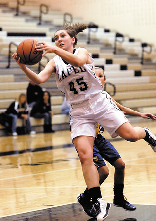 Lapel's Morgan Tarlton goes strong to the basket driving through the Tri-Central defense.
