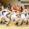 The Madison-Grant Argylls huddle before facing the Liberty Christian Lions on Tuesday.