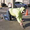 Jamie Thixton with Case Construction of Edinburgh Ind. finishes a sidewalk repair at the intersection of 10th and Jackson on Wednesday. The section of sidewalk was tore up to as part of Vectran's project to replace aging cast iron and bare steel pipeline with new industry-standard plastic pipes and connections.
