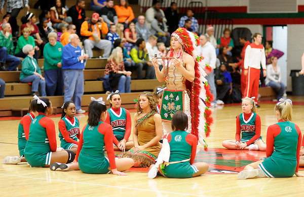 The Anderson Indian, Indian Maiden and cheerleaders perform the traditional peace pipe ceremony as the Indians hosted Huntington North on Friday.