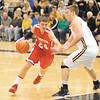 Frankton senior Trevor Hughes drives past Lapel defender Dane Mason during the Bulldogs and Eagles game Saturday at Lapel High School.