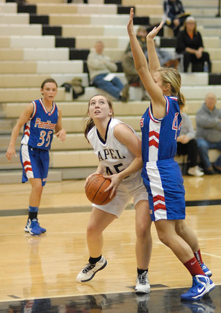 Lapel Lady Bulldog Morgan Tarlton goes in for a lay up during Tuesday night's home game against Elwood High School.