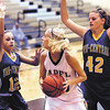 Lapel's Kaitlin Dobbins looks to the basket as Tri-Central's haley Farris and Cecelia Rayl try to box her in.